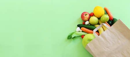 top view of healthy shopping bag with fresh fruits and vegetables. banner image