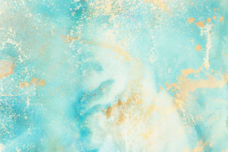 art photography of abstract fluid art painting with alcohol ink, blue and gold colors Standard-Bild
