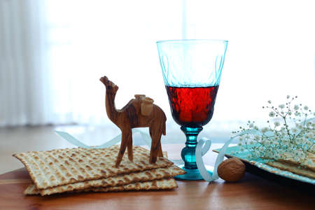 Passover background. Glass Wine cup and matzoh (jewish holiday bread)