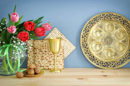 Pesah celebration concept (jewish Passover holiday). Traditional pesah plate text in hebrew: Passover, horseradish, celery, egg, bone, maror, sweet dates jam
