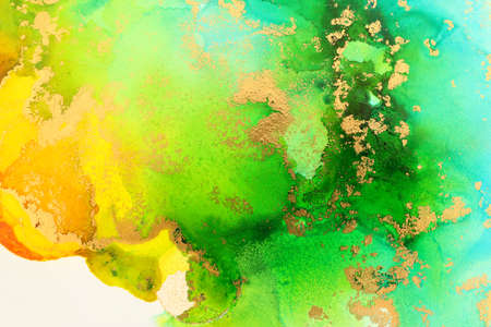 art photography of abstract fluid art painting with alcohol ink, ocean colors, green, turquoise, blue and gold
