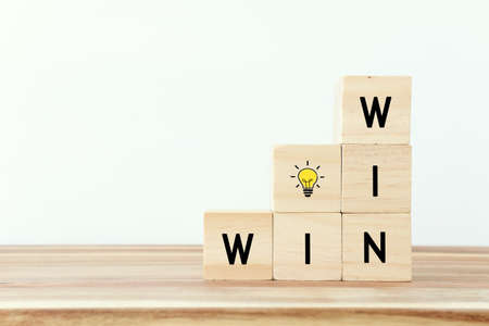 Wooden cubes stack with the text win-win-situation. Strategy and business concept