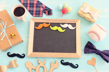 top view image of fathers day composition with vintage father's accessories and blackboard