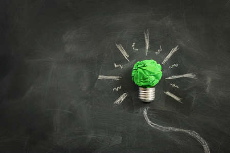 Concept image if green crumpled paper lightbulb, symbol of scr, innovation and eco friendly business Standard-Bild