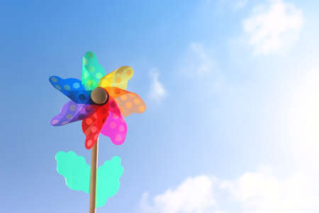 Image of Colorful pinwheel against blue sky