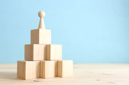 business concept image of people figures over wooden blocks and table, human resources and management concept