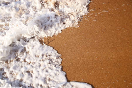 top view image of sea waves and beach sand Standard-Bild