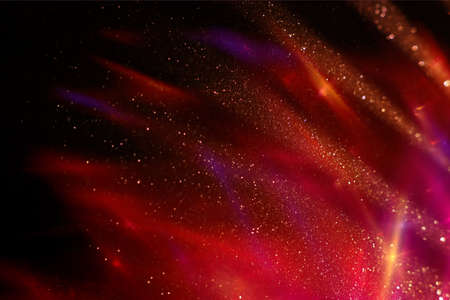 background of abstract gold and red glitter lights. defocused