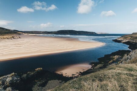 Sandy beach with blue sky at Bettyhill, Sutherland, Scotland. Stock Photo