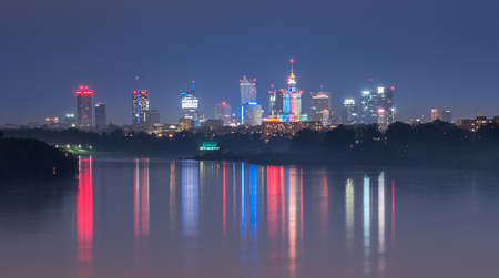 Colorful night panorama of Warsaw skyline, Poland, over Vistula river in the night Reklamní fotografie