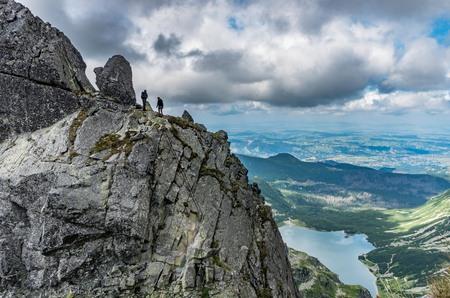 orla: Poland, tatra mountains landscape, tourists on the Eagles Path (Orla Perc) ridge