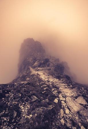 orla: Tatra mountains, Poland, tourist trail on Pomegranate (Orla Perc - Eagles path) in the fog Stock Photo
