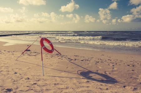 Lifebuoy on Baltic coast, Row, y Poland Stock Photo