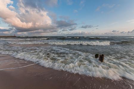 Waves on Baltic coast - seascape at sunrise, Poland Stock Photo