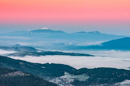 Misty mountain landscape in the morning with Babia Gora mountain, Poland