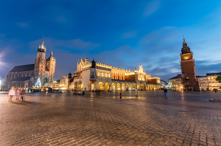 St Marys church, Cloth Hall and Town Hall on the Main Market Square in Krakow, illuminated in the night