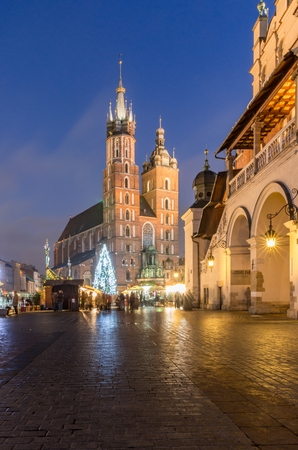 Christmas tree, St Marys church, Cloth Hall on Main Market Square in Krakow, illuminated in the night