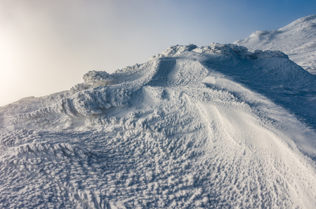 Winter landscape - snow pattern created by the wind