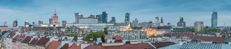 Warsaw, Poland, panorama of city center with modern skyscrapers and old city roofs