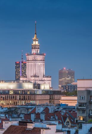 Warsaw, Poland, communist skyscraper Palace of Culture and Science over old city roofs Stock Photo