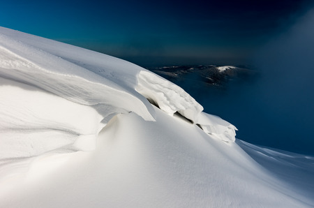 Snow bank form created by the wind
