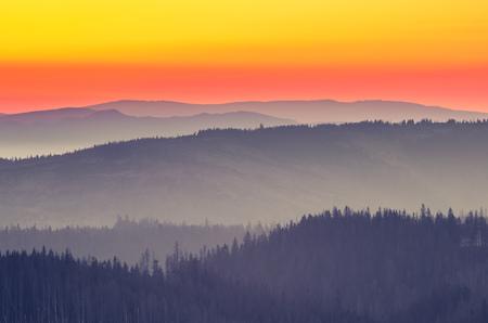 Moments before sunrise in misty Carpathian mountains, Poland