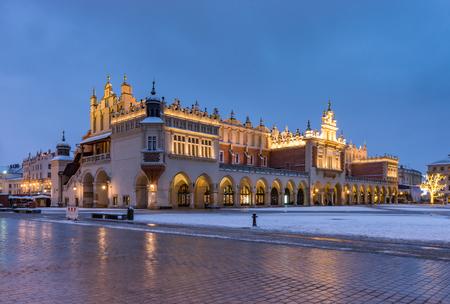 Krakow, Poland, Cloth Hall (sukiennice) on Main Market Square (Rynek Glowny) winter night Фото со стока