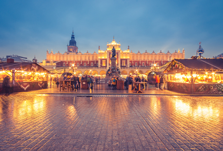 Krakow, Poland, Main Square, Cloth Hall, Mickiewicz statue and Christmas fairs
