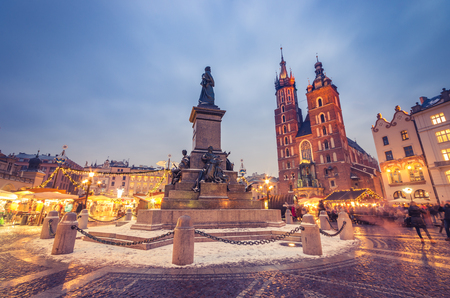 Krakow, main square winter evening, christmas fairs, Mickiewicz statue and St Mary church