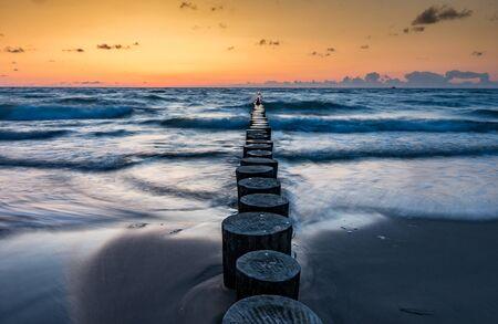 Evening sea coast, waves breaking on breakwater, Baltic sea Poland