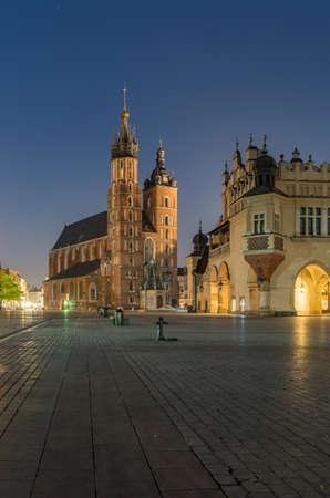 Main market square, Cloth Hall and St Mary's church in the night, Krakow, Poland