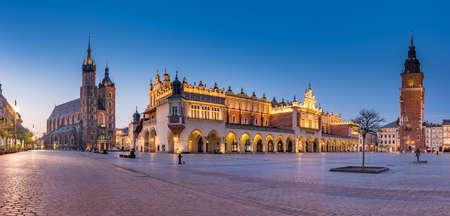 Krakow, Poland, main square night panorama with Cloth Hall and St Mary's church
