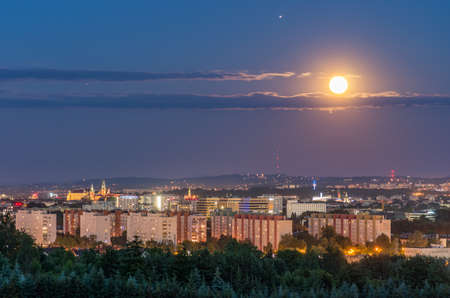 Full moon over Krakow, Poland, seen from Bronowice district