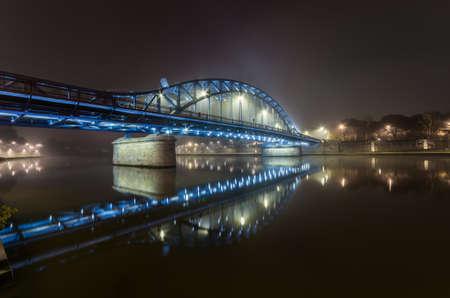 Krakow Poland, Pilsudski bridge over Vistula river in the night 스톡 콘텐츠