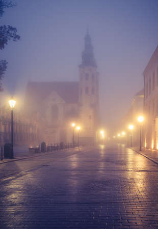 Krakow old town, St Andrew church on Grodzka street in the foggy night 스톡 콘텐츠