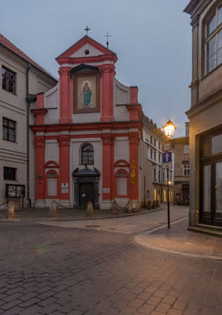 St Tomas and St John street crossing in the night and St John church, Krakow, Poland, old city 스톡 콘텐츠
