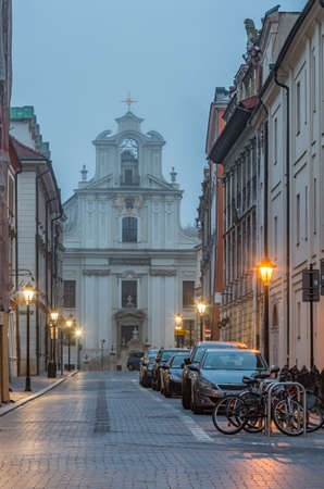 St John street in the night and piarist church, Krakow, Poland, old city