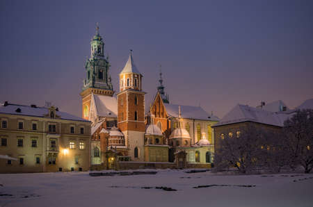 Wawel castle and cathedral covered with snow on winter night, Krakow, Poland