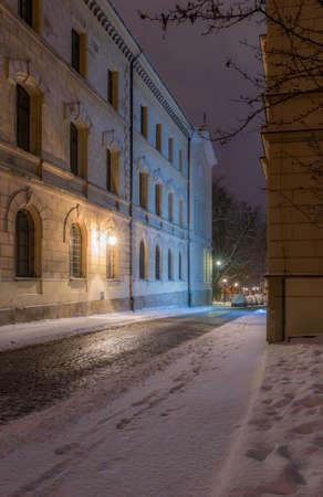 Winter in Krakow, Poselska street covered in snow, night, Poland