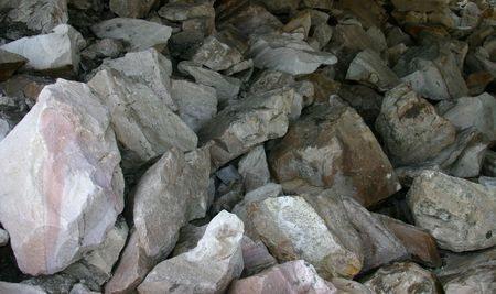 immovable: Boulders Beneath a Bridge Stock Photo