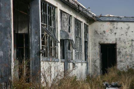 Derelict warehouse building shot against a darkening sky on former Orlando Naval Air Station