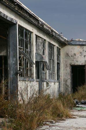 window graffiti: Derelict warehouse building shot against a darkening sky on former Orlando Naval Air Station