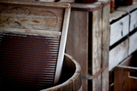 washboard: Image of a washboard in a barrel at the Fort Christmas Historical Park; Christmas Florida. Stock Photo