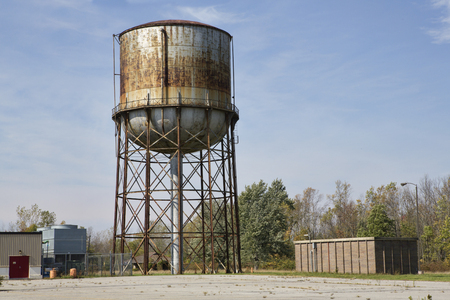 steel tower: Rusting water tower at an abandoned government medical facility in Western New York State. Stock Photo