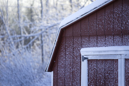 blanketed: 9 January 2015; Alden, NY - Snow from a lake affect storm adorns the side of a shed in the Western New York area. This image shows a little of the beauty of the light, powdery snow thats blanketed the area.