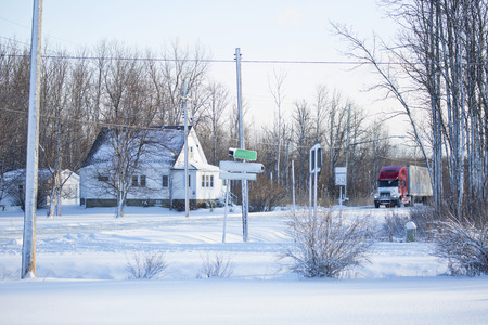 treacherous: 9 January 2015; Alden, NY - Snow from a lake affect storm continues to fall across the Western New York area, reducing visibility and making driving treacherous. This image shows the beauty of the light, powdery snow thats blanketed the area.
