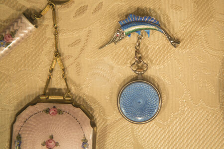 buff: Victorian Era jewelry displayed on a buff colored cloth. Stock Photo