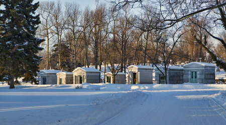 silently: Mausoleum sits silently in the deep snows of Winter in Buffalos Forest Lawn Cemetery. Stock Photo