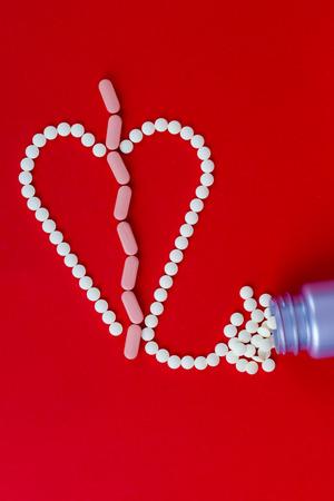 Broken heart made with pills Standard-Bild