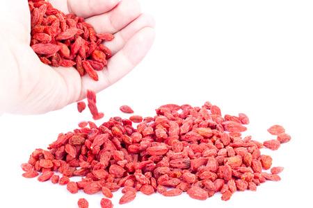 Goji berries in a hand Standard-Bild